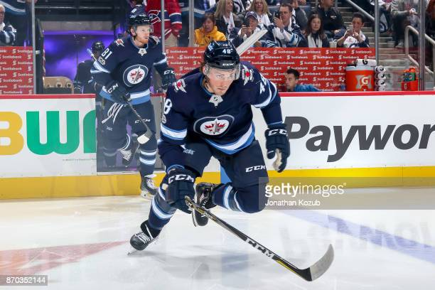 Brendan Lemieux of the Winnipeg Jets hits the ice prior to puck drop against the Pittsburgh Penguins at the Bell MTS Place on October 29 2017 in...