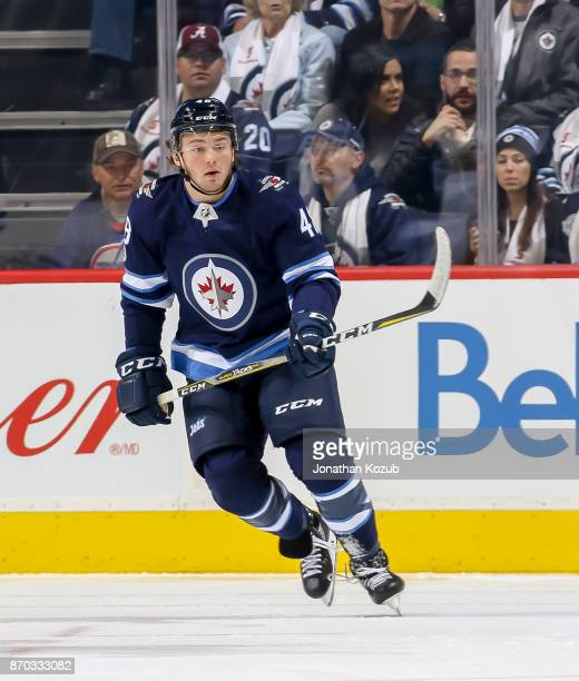 Brendan Lemieux of the Winnipeg Jets keeps an eye on the play during first period action against the Pittsburgh Penguins at the Bell MTS Place on...
