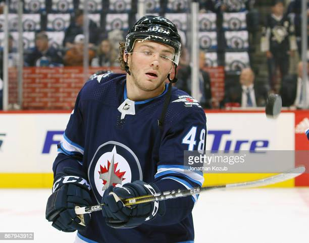 Brendan Lemieux of the Winnipeg Jets keeps his eyes on the puck during the pregame warm up prior to NHL action against the Pittsburgh Penguins at the...