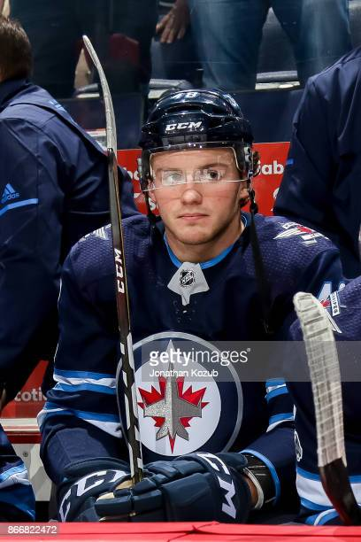 Brendan Lemieux of the Winnipeg Jets looks on from the bench prior to puck drop against the Minnesota Wild at the Bell MTS Place on October 20 2017...