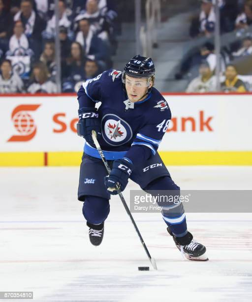 Brendan Lemieux of the Winnipeg Jets plays the puck down the ice during first period action against the Pittsburgh Penguins at the Bell MTS Place on...