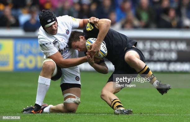 Brendan Macken of Wasps is tackled by Charlie Ewels during the Aviva Premiership match between Wasps and Bath Rugby at The Ricoh Arena on October 1...