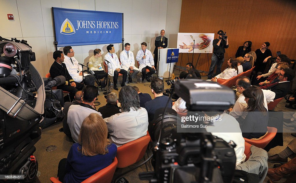 Brendan Marrocco attends a press conference, January 29, 2013, held at Johns Hopkins Hospital in Baltimore, Maryland, with his team of doctors to discuss his bilateral arm transplant surgery, which was done on Dec. 18, 2012. Marrocco lost all four limbs in a roadside bomb attack in Iraq in 2009. Marrocco, from Staten Island, New York, is the first successful double arm transplant at Hopkins, and only the 7th patient in the U.S. to undergo this surgery.