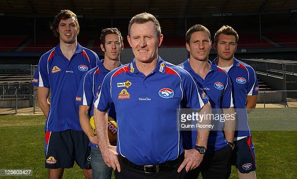 Brendan McCartney the newly appointed coach of the Western Bulldogs poses with Ayce Cordy Robert Murphy Matthew Boyd and Shaun Higgins during a...