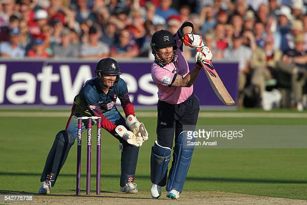 Brendan McCullum of Middlesex bats as Kent wicket keeper Sam Billings looks on during the Natwest T20 Blast match between Kent and Middlesex at The...