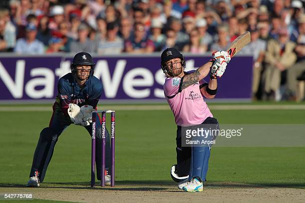 Brendan McCullum of Middlesex hits a six as Kent wicket keeper Sam Billings looks on during the Natwest T20 Blast match between Kent and Middlesex at...