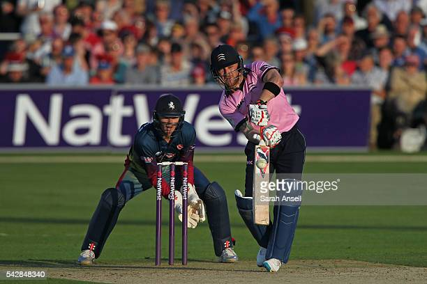 Brendan McCullum of Middlesex hits out as Kent wicket keeper Sam Billings looks on during the Natwest T20 Blast match between Kent and Middlesex at...