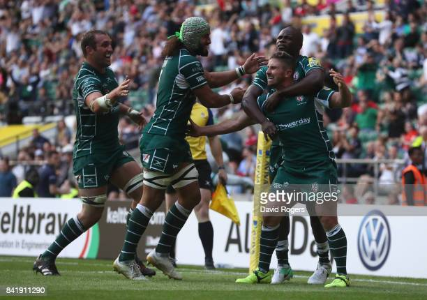 Brendan McKibbin of London Irish celebrates with team mates as he scores their fourth try during the Aviva Premiership match between London Irish and...