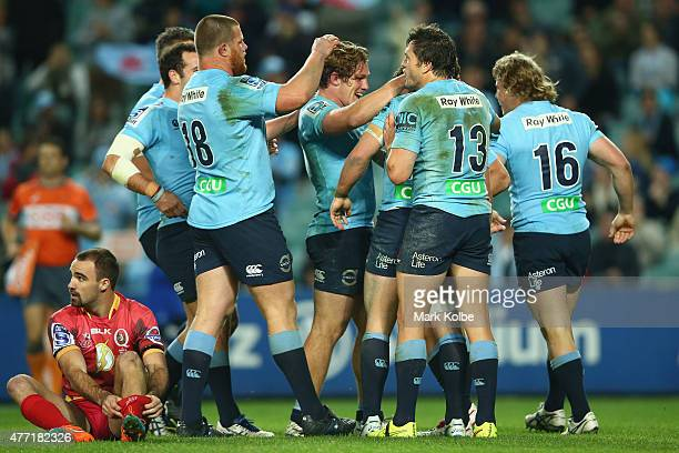 Brendan McKibbin of the Waratahs celebrates with his team mates after scoring a try during the round 18 Super Rugby match between the Waratahs and...