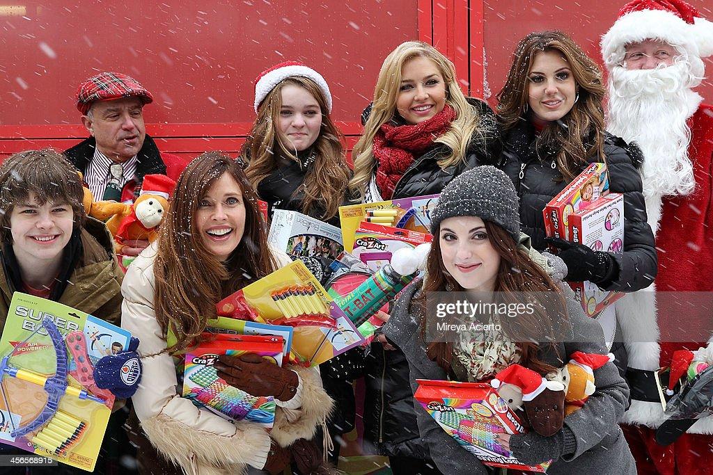 L-R) Brendan Meyer, Anthony Laciura, Carol Alt, Kerris Dorsey, Cassidy Wolf, Juliette Goglia, Erin Brady attend CitySightseeing New York 2013 holiday toy drive at PAL's Harlem Center on December 14, 2013 in New York City.