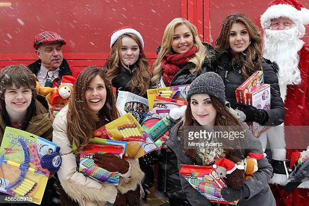 R Brendan Meyer Anthony Laciura Carol Alt Kerris Dorsey Cassidy Wolf Juliette Goglia Erin Brady attend CitySightseeing New York 2013 holiday toy...