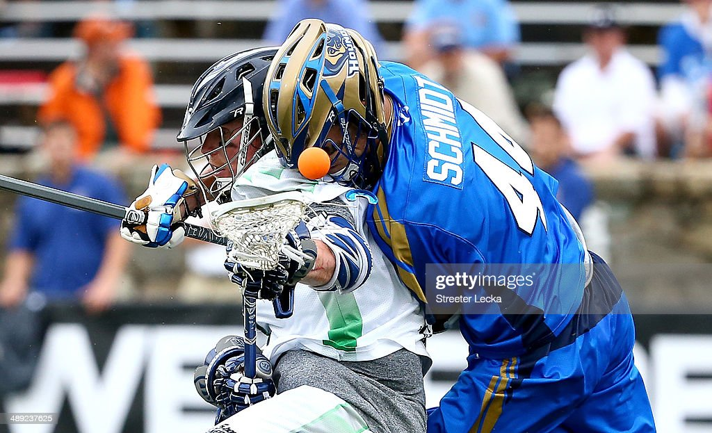 Brendan Mundorf of the Chesapeake Bayhawks and Brett Schmidt of the Charlotte Hounds collide during their game at American Legion Memorial Stadium on...