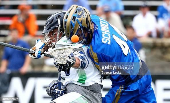 Brendan Mundorf of the Chesapeake Bayhawks and Brett Schmidt of the Charlotte Hounds collide during their game at American Legion Memorial Stadium on...