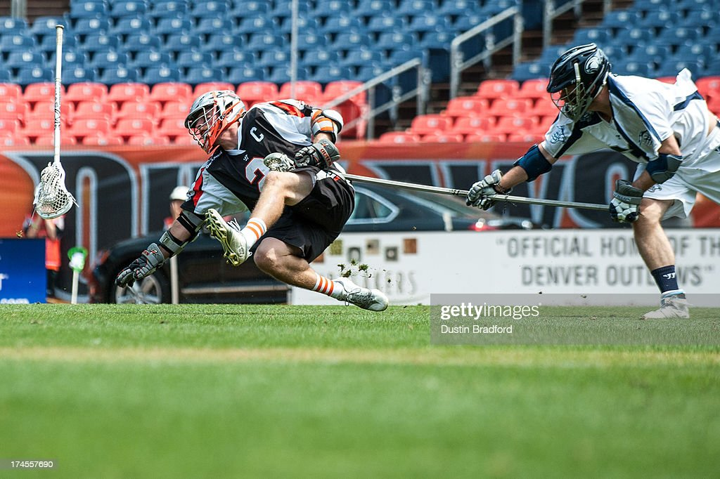 <a gi-track='captionPersonalityLinkClicked' href=/galleries/search?phrase=Brendan+Mundorf&family=editorial&specificpeople=5984390 ng-click='$event.stopPropagation()'>Brendan Mundorf</a> #2 of the Denver Outlaws has his stick and the ball knocked loose by Michael Evans #33 of the Chesapeake Bayhawks during a Major League Lacrosse game at Sports Authority Field at Mile High on July 27, 2013 in Denver, Colorado. The Outlaws beat the Bayhawks 14-12.