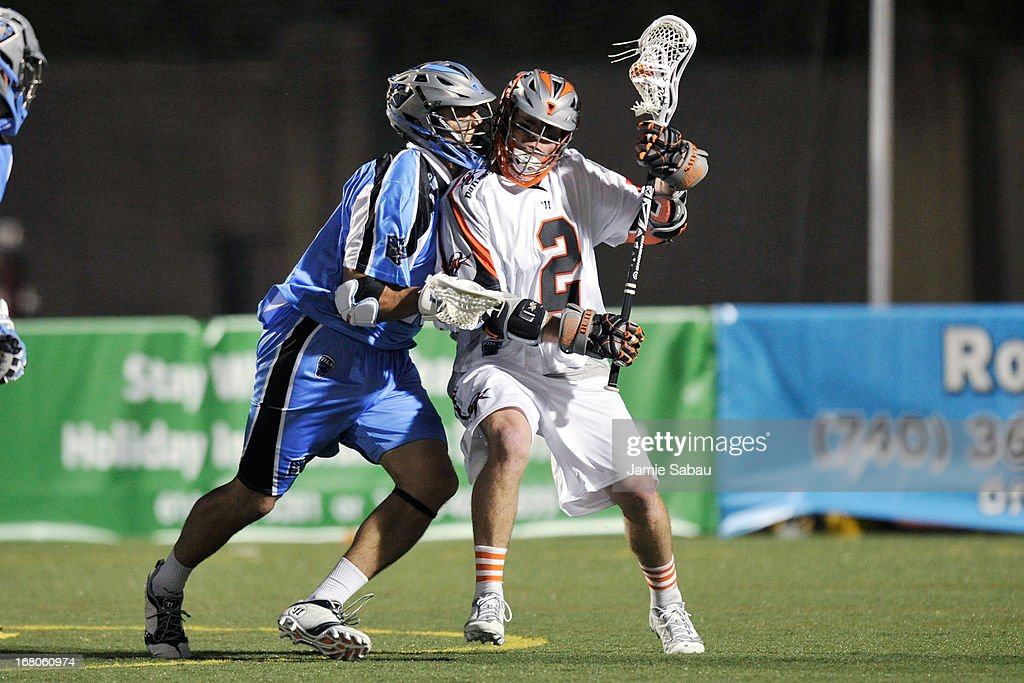 <a gi-track='captionPersonalityLinkClicked' href=/galleries/search?phrase=Brendan+Mundorf&family=editorial&specificpeople=5984390 ng-click='$event.stopPropagation()'>Brendan Mundorf</a> #2 of the Denver Outlaws maintains control of the ball as Diogo Godoi #18 of the Ohio Machine applies defensive pressure in the second half on May 4, 2013 at Selby Stadium in Delaware, Ohio.