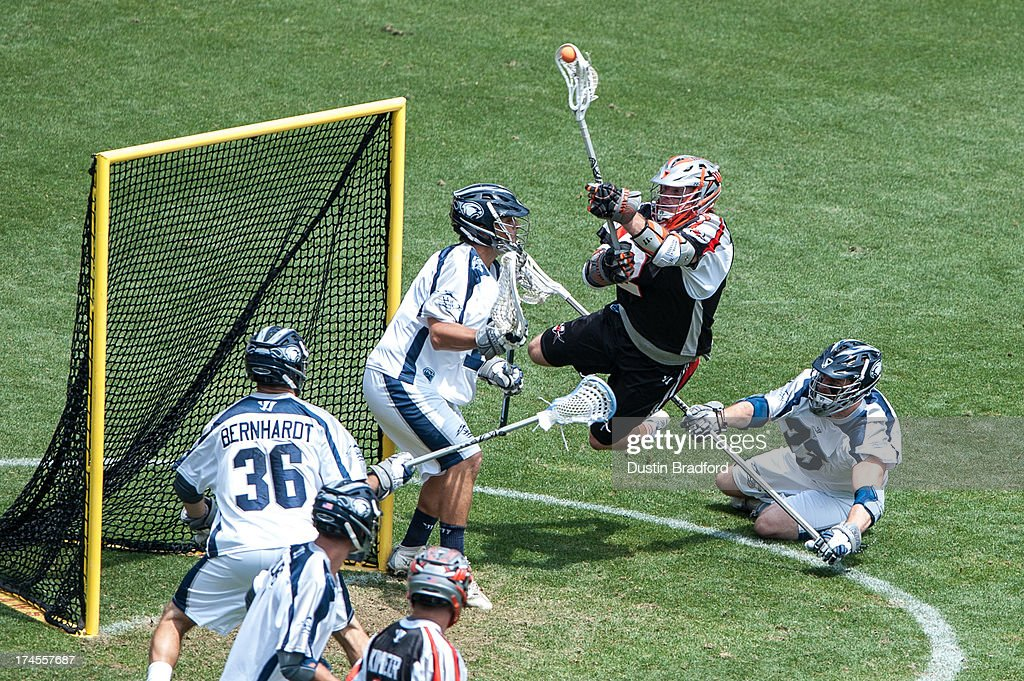 <a gi-track='captionPersonalityLinkClicked' href=/galleries/search?phrase=Brendan+Mundorf&family=editorial&specificpeople=5984390 ng-click='$event.stopPropagation()'>Brendan Mundorf</a> #2 of the Denver Outlaws makes a point-blank diving attempt to get the ball past Kip Turner #15 of the Chesapeake Bayhawks during a Major League Lacrosse game at Sports Authority Field at Mile High on July 27, 2013 in Denver, Colorado. The Outlaws beat the Bayhawks 14-12.