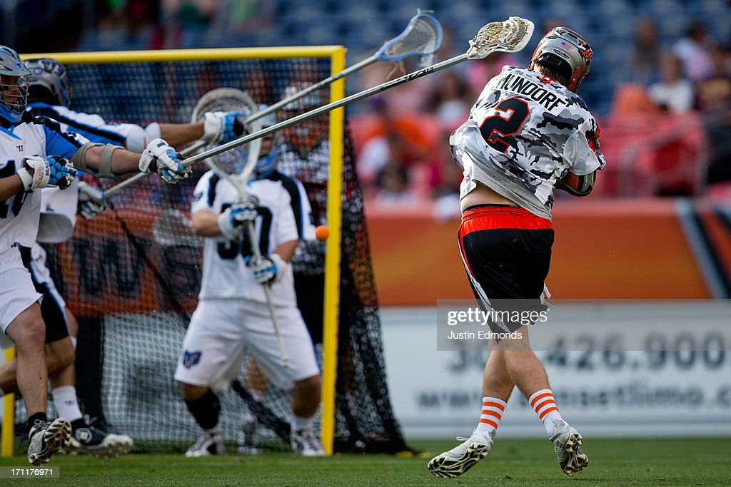 Brendan Mundorf #2 of the Denver Outlaws shoots and scores during the first quarter against the Ohio Machine at Sports Authority Field at Mile High on June 22, 2013 in Denver, Colorado.