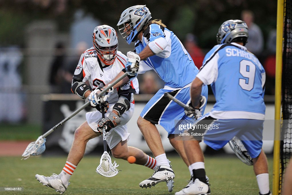 <a gi-track='captionPersonalityLinkClicked' href=/galleries/search?phrase=Brendan+Mundorf&family=editorial&specificpeople=5984390 ng-click='$event.stopPropagation()'>Brendan Mundorf</a> #2 of the Denver Outlaws tosses in the ball low for a goal past <a gi-track='captionPersonalityLinkClicked' href=/galleries/search?phrase=Greg+Bice&family=editorial&specificpeople=7620903 ng-click='$event.stopPropagation()'>Greg Bice</a> #44 and Stefan Schroder #9 of the Ohio Machine in the first period on May 4, 2013 at Selby Stadium in Delaware, Ohio.