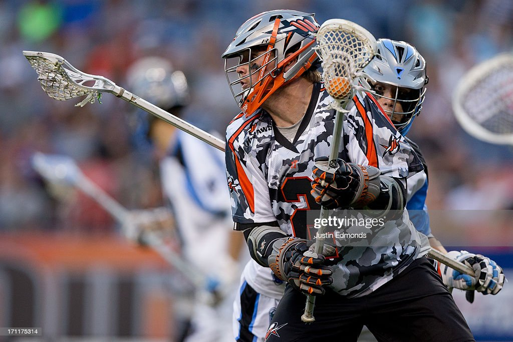 Brendan Mundorf #2 of the Denver Outlaws tries to elude Chad Wiedmaier #55 of the Ohio Machine during the third quarter at Sports Authority Field at Mile High on June 22, 2013 in Denver, Colorado. The Outlaws defeated the Machine 19-5 to improve to 8-0 on the season.