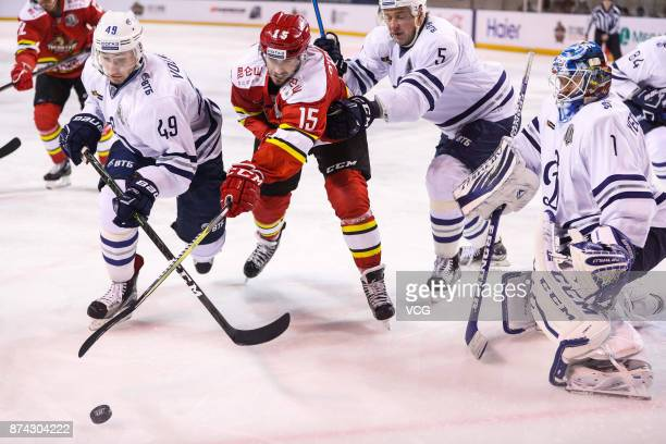 Brendan O'Donnell of HC Kunlun Red Star and Artyom Volkov of HC Dynamo Moscow vie for the puck during the 2017/18 Kontinental Hockey League Regular...