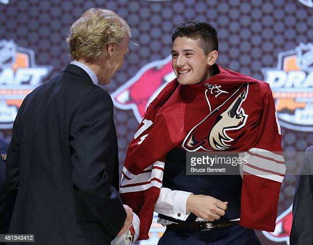 Brendan Perlini is selected twelfth by the Arizona Coyotes in the first round of the 2014 NHL Draft at the Wells Fargo Center on June 27 2014 in...