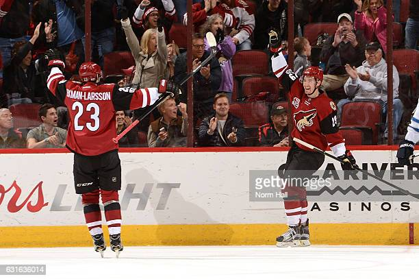 Brendan Perlini of the Arizona Coyotes celebrates a goal with teammate Oliver EkmanLarsson during the first period against the Winnipeg Jets at Gila...