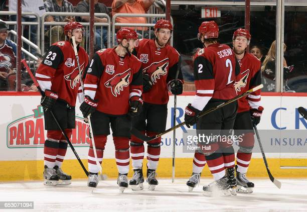 Brendan Perlini of the Arizona Coyotes is congratulated by teammates Oliver EkmanLarsson Tobias Rieder Luke Schenn and Peter Holland after scoring a...