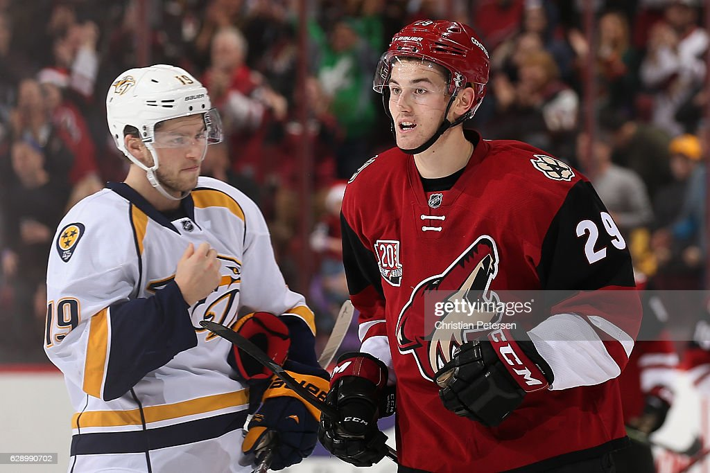 Brendan Perlini #29 of the Arizona Coyotes reacts alongside Calle Jarnkrok #19 of the Nashville Predators after Perlini scored his first career goal during the second period of the NHL game at Gila River Arena on December 10, 2016 in Glendale, Arizona.