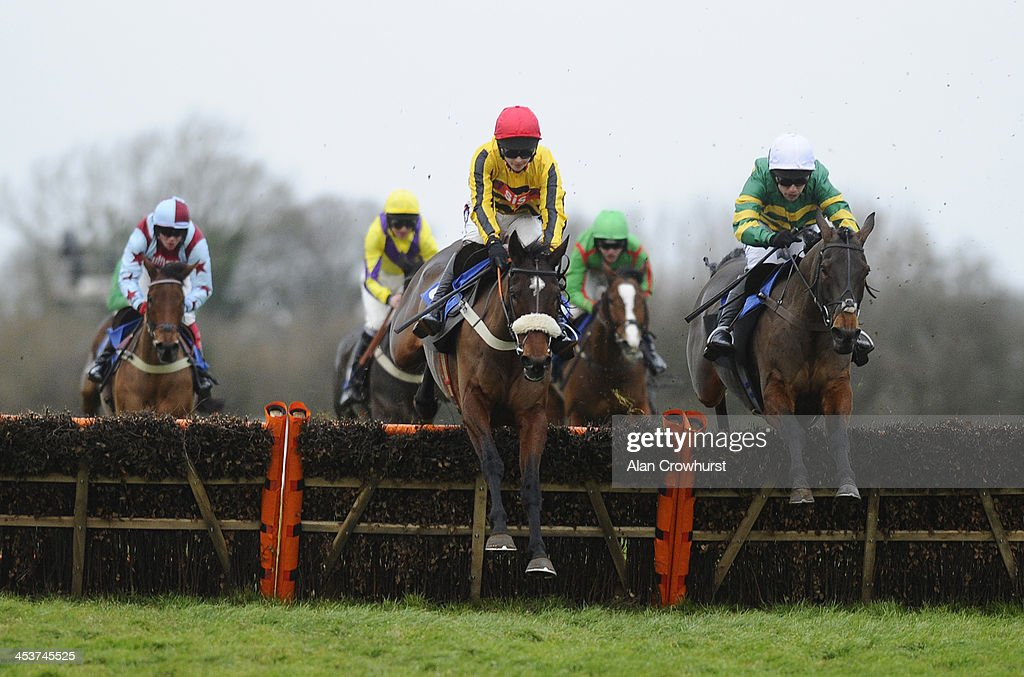 Brendan Powell riding Jumps Road (C) clear the last to win The Weatherbys Hamilton Insurance Handicap Hurdle Race at Wincanton racecourse on December 05, 2013 in Wincanton, England.