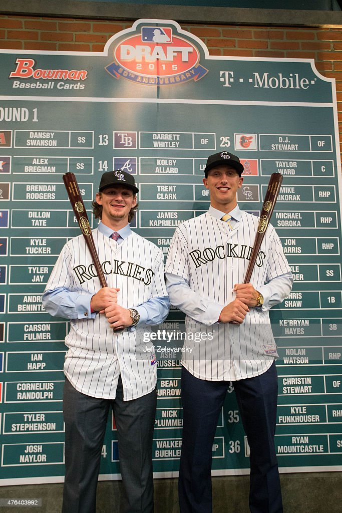 Brendan Rodgers and Mike Nikorak pose for a photo after the first round during the 2015 Major League Baseball FirstYear Player Draft at MLB Network's...
