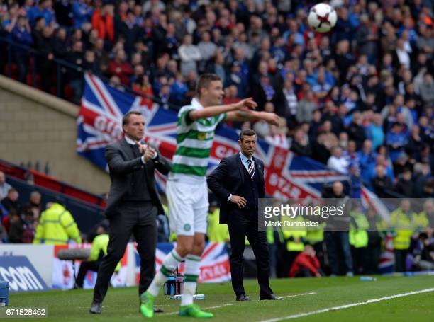 Brendan Rodgers manager of Celtic and Pedro Caixinha manager of Rangers look on from the touchline during the Scottish Cup SemiFinal match between...
