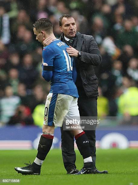 Brendan Rodgers manager of Celtic consoles Barrie McKay of Rangers after the Ladbrokes Scottish Premiership match between Rangers and Celtic at Ibrox...
