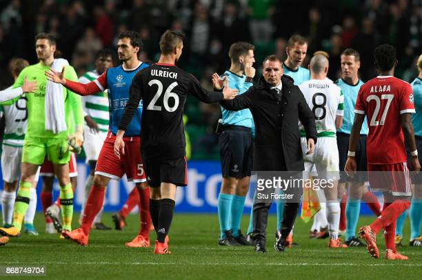 Brendan Rodgers manager of Celtic shakes hands with KSven Ulreich of Bayern Muenchen following the UEFA Champions League group B match between Celtic...