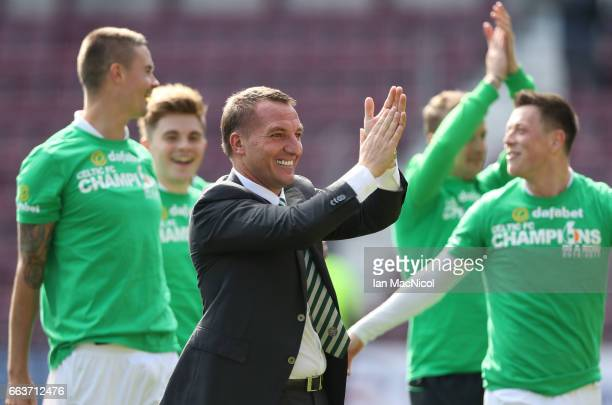 Brendan Rodgers manager of Celtic shows appreciation to the fans after winning the league title after beating Hearts 50 during the Ladbrokes Scottish...