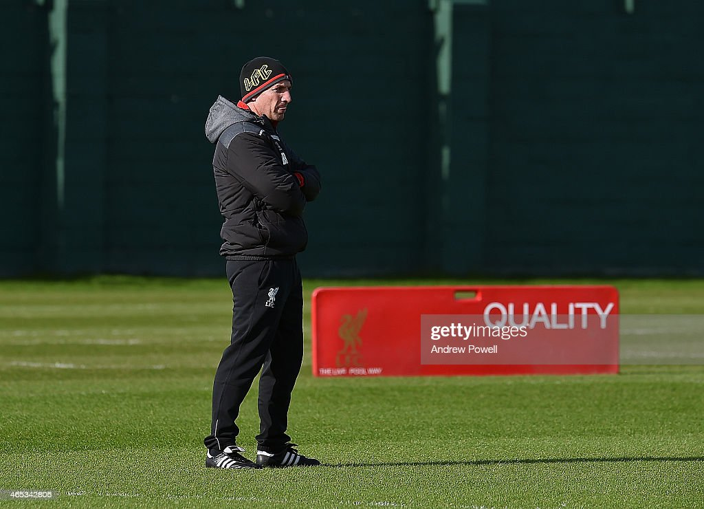 Brendan Rodgers manager of Liveprool looks on during a training session at Melwood Training Ground on March 6 2015 in Liverpool England