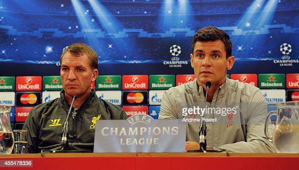 Brendan Rodgers manager of Liverpool and Dejan Lovren of Liverpool during a Press Conference at Anfield on September 15 2014 in Liverpool England