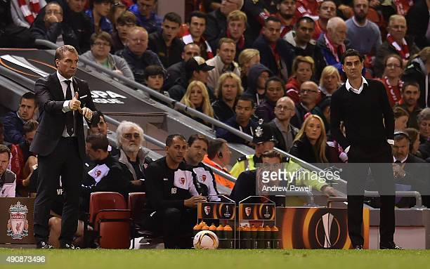 Brendan Rodgers manager of Liverpool and Didier Tholot manager of FC Sion react during the UEFA Europa League match between Liverpool and FC Sion on...
