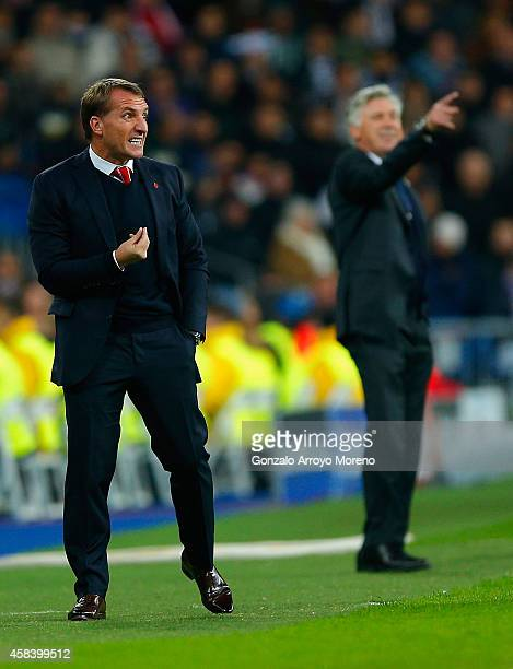 Brendan Rodgers manager of Liverpool and Head Coach Carlo Ancelotti of Real Madrid CF give instructions from the touchline during the UEFA Champions...