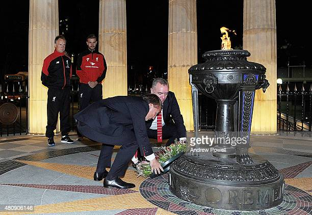 Brendan Rodgers manager of Liverpool and Ian Ayre chief executive officer of Liverpool lay a wreath as Jordan Henderson captain of Liverpool Sean...