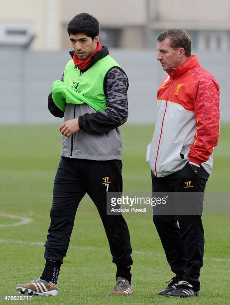 Brendan Rodgers manager of Liverpool and Luis Suarez captian of Liverpool talking during a training session at Melwood Training Ground on March 14...