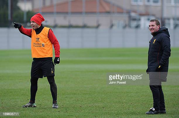 Brendan Rodgers manager of Liverpool and Luis Suarez during a training session at Melwood Training Ground on January 17 2013 in Liverpool England