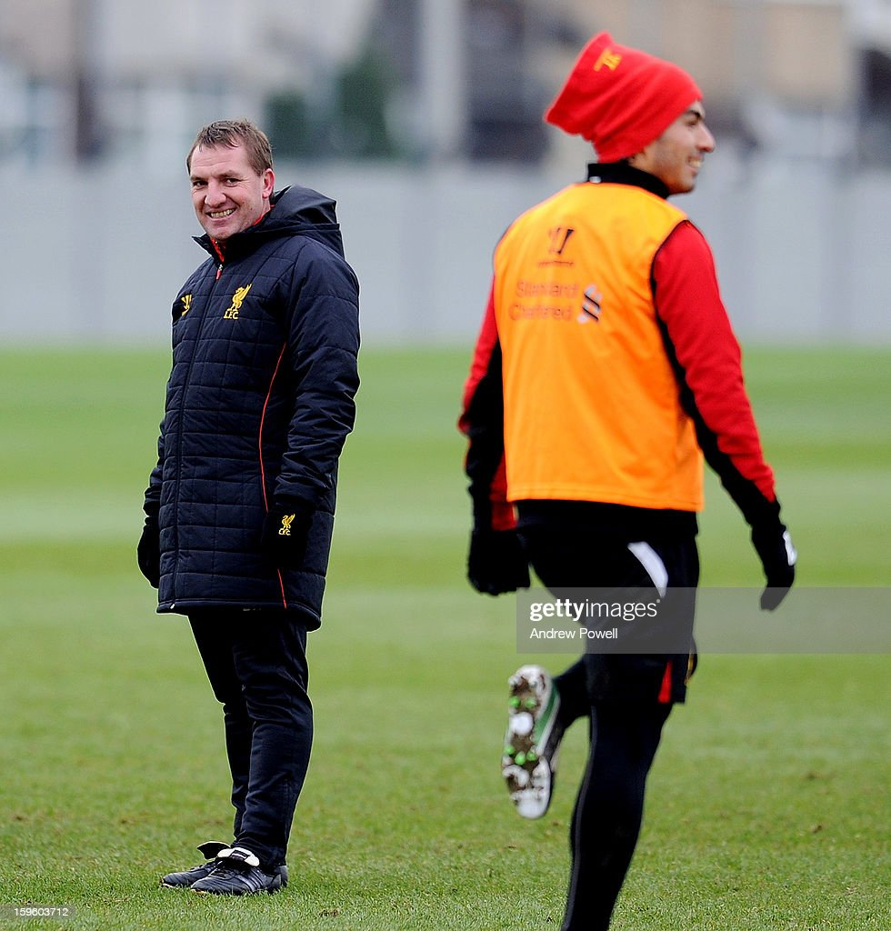 Brendan Rodgers, manager of Liverpool and Luis Suarez during a training session at Melwood Training Ground on January 17, 2013 in Liverpool, England.