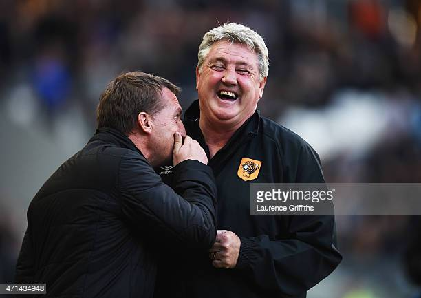 Brendan Rodgers manager of Liverpool and Steve Bruce manager of Hull City share a joke prior to the Barclays Premier League match between Hull City...