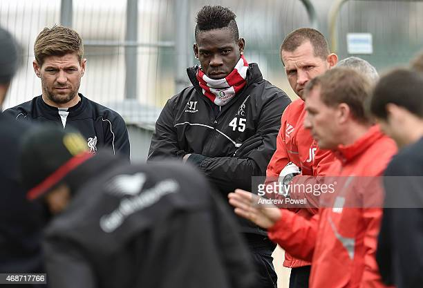 Brendan Rodgers manager of Liverpool and Steven Gerrard and Mario Balotelli during a training session at Melwood Training Ground on April 6 2015 in...