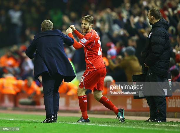 Brendan Rodgers manager of Liverpool celebrates with Adam Lallana of Liverpool as Glen Johnson scores their first goal during the Barclays Premier...