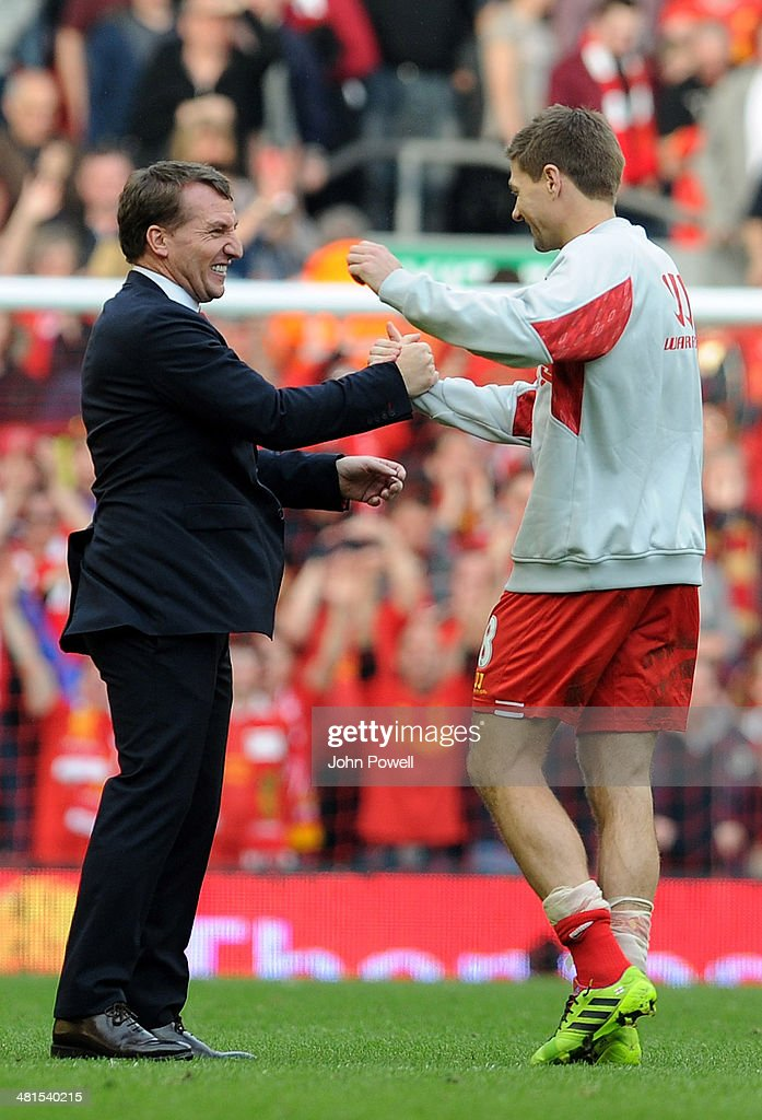 Brendan Rodgers manager of Liverpool celebrates with Captain Steven Gerrard of Liverpool at the end of the Barclays Premier League match between Liverpool and Tottenham Hotspur at Anfield on March 30, 2014 in Liverpool, England.