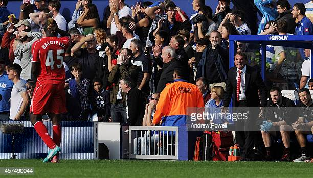 Brendan Rodgers manager of Liverpool gestures towards Mario Balotelli during the Barclays Premier League match between Queens Park Rangers and...