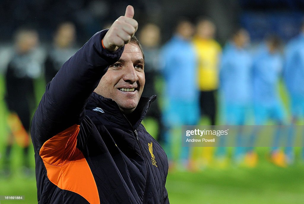 <a gi-track='captionPersonalityLinkClicked' href=/galleries/search?phrase=Brendan+Rodgers+-+Soccer+Manager&family=editorial&specificpeople=5446684 ng-click='$event.stopPropagation()'>Brendan Rodgers</a> manager of Liverpool gives a thumbs up to the crowd before the UEFA Europa League round of 32 first leg match between FC Zenit St Petersburg and Liverpool on February 14, 2013 in Saint Petersburg, Russia.