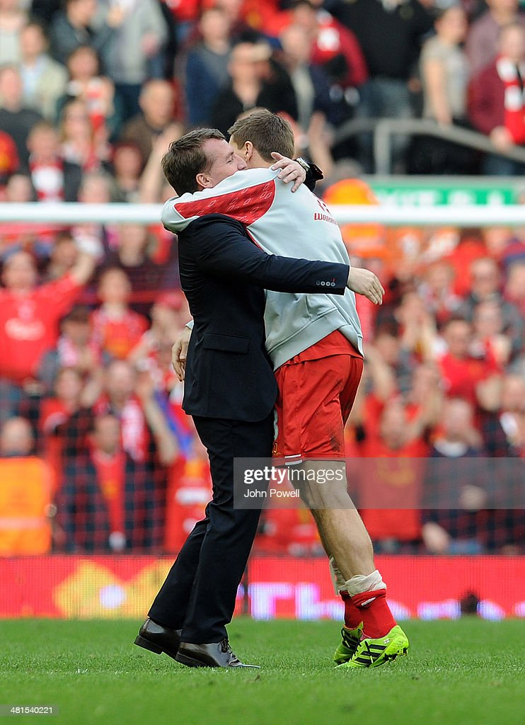 Brendan Rodgers manager of Liverpool hugs Captain Steven Gerrard of Liverpool at the end of the Barclays Premier League match between Liverpool and Tottenham Hotspur at Anfield on March 30, 2014 in Liverpool, England.