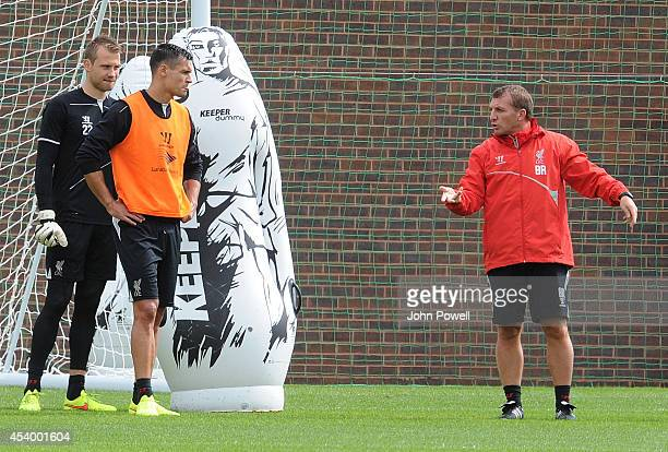 Brendan Rodgers manager of Liverpool instructs Simon Mignolet of Liverpool and Dejan Lovren of Liverpool during a training session at Melwood...